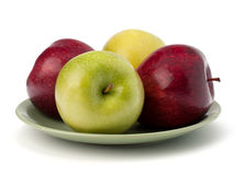 Apples pile on plate Royalty Free Stock Photo