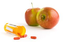Apples and pills royalty free stock photography