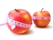 Apples with pink tape measure. Over white background (concept of health, diet Royalty Free Stock Photo