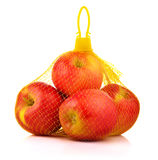 Apples in Plastic Mesh Sack on White Background Stock Images