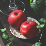 Red apples on a plate. Still life stock image