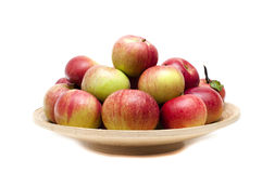 Apples on the plate Stock Photos