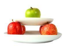 Apples on plates Royalty Free Stock Photography