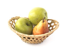 Apples and plum in wicker basket Royalty Free Stock Photos