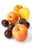 Apples and plums. Colorful apples and plums on white background Royalty Free Stock Photography