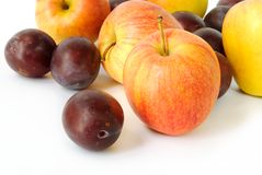 Apples and plums. Colorful apples and plums on white background Royalty Free Stock Images
