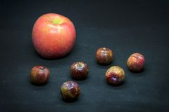 Apples and plums. Are good for health, images are fine in the culinary press and decorating the dining room Royalty Free Stock Images