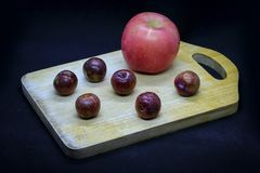 Apples and plums Royalty Free Stock Photos
