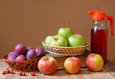 Apples and plums with juice Stock Photography
