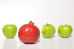 Apples and a Pomegranate Royalty Free Stock Photos