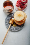 Apples, pomegranate and honey for Rosh Hashanah Stock Images