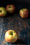 Apples on Primitive Blue Background royalty free stock photos