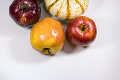 Apples pumpkin on white. Apples and garlic on a white background Royalty Free Stock Photos