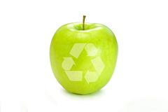 Apples Recycle. The Recycle symbol on a bright green apple symbolizing green living Royalty Free Stock Photos