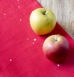 Apples on a red cloth. The apples lying on the red cloth Stock Photography