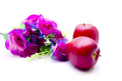 Apples and red flowers. On white background Royalty Free Stock Photos