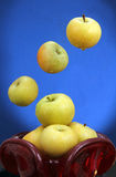 Apples in a red glass vase. Royalty Free Stock Photos