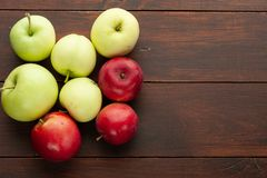 Red apples on the rustic wooden table royalty free stock images