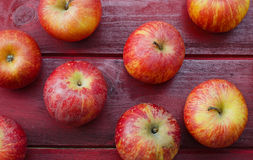Apples on Red Wood Stock Images