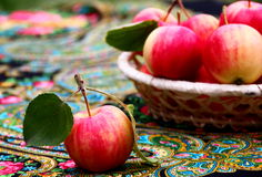 Apples. Red-yellow little  apples on the table Royalty Free Stock Images