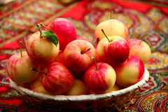 Apples. Red-yellow little  apples on the table Royalty Free Stock Photo