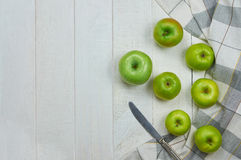 Apples. Ripe green apples on light wooden background. Nature fruit concept. Top view. Close-up. Selective focus Stock Image