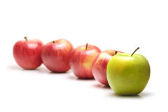 Apples in a row, green leading Stock Photo
