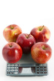Apples on scale Stock Images