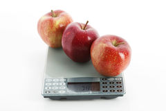 Apples on scale Royalty Free Stock Images