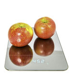 Apples on the scale. Symbolic photo for weight loss Stock Photos