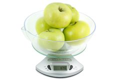 The apples on the scales Royalty Free Stock Photos