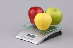 Apples on scales Royalty Free Stock Image
