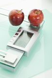Apples on scales,close up Royalty Free Stock Photo
