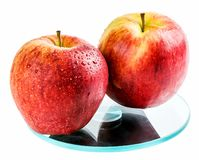 Apples on the scales Stock Photo