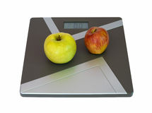 Apples on scales Royalty Free Stock Photos