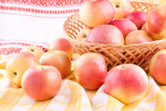 The apples scattered on the tablecloth Royalty Free Stock Photo