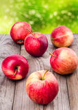 Apples scattered. On the wooden table Royalty Free Stock Photo