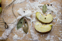 Apples seasonings ,in flour on a cutting Board. stock photo