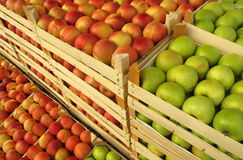 Apples in selling crates on market Stock Photo