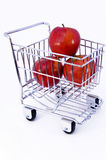 Apples in shopping cart. Isolated Stock Photos