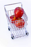 Apples in shopping cart. Isolated Stock Photo
