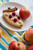 Apples and slice of cottage cheese quiche. Delicious cottage cheese quiche on plate Stock Photos