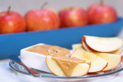 Apples and slices with peanut stock photography