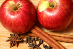 Apples with spices. Two juicy apples with spices on the wooden table Stock Photo