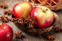 Apples with spices on a wooden background Royalty Free Stock Images