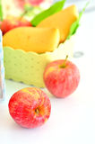 Apples spilling from basket Royalty Free Stock Image