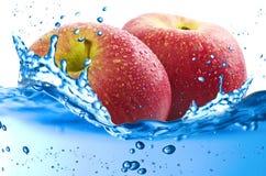 Apples splash Stock Photo