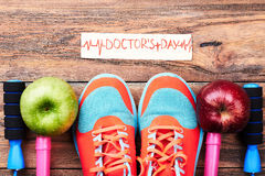 Apples, sport shoes and card. Stock Images
