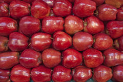 Apples in stack. Fresh stacked apples at farmer's stand Royalty Free Stock Photo