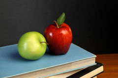 Apples on stack of books. Red and green apple on stack of books Royalty Free Stock Images